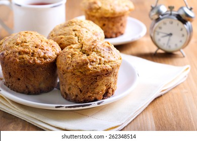 Morning muffins full of carrot, fruit and nut