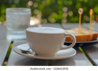Morning cappuccino coffee and bokeh nature background