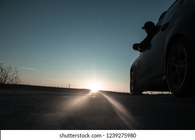 morning next to the car