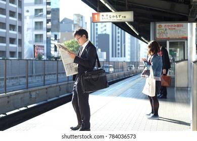 In the morning november 3 ,2016. the salaryman start the day at JR train in Osaka ,Japan.