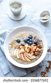 morning oat porridge with fresh fruits and tea