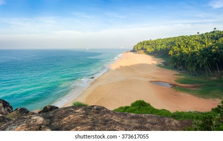 Morning on the beach, sand, palm trees and the sea. India, Kerala, Kovalam