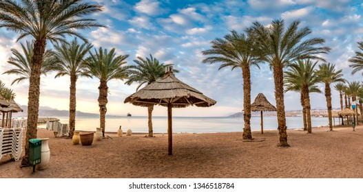 Morning on central public beach of Eilat - famous tourist resort and recreational city in Israel and Middle East, panoramic image