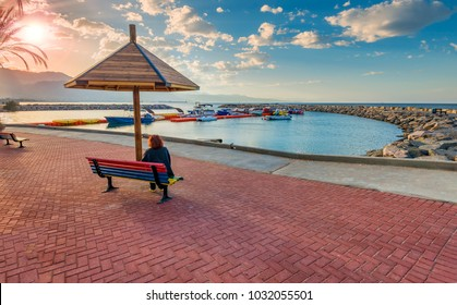 Morning on central public promenade and stone pier in Eilat -t he southernmost marine port and famous resort and recreational city in Israel and the Middle East