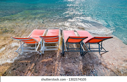 Morning on a public beach of Eilat - number one tourist resort and recreational city in Israel located on the Red Sea