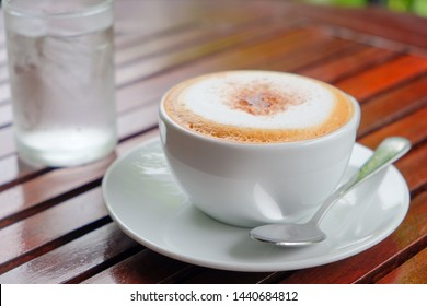 Morning cappuccino​ coffee​ on table