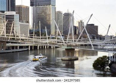morning over water view of Brisbane, Australia, Queensland, cityscape with river, bridge and river transport