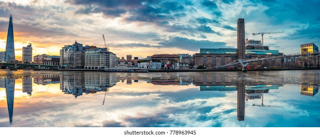 Morning panorama of London bankside district including Millenium bridge and reflections