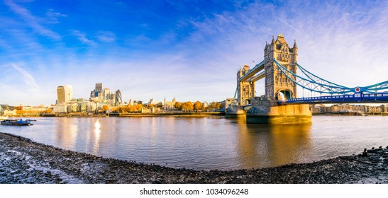 Morning panorama of London Tower Bridge and skyscrapers in financial district in London, UK