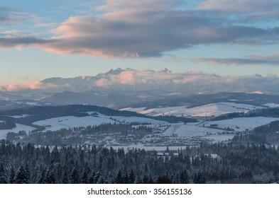 Morning panorama of snowy Tatra Mountains over Spisz Highland, Poland