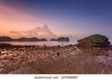 Morning panorama of surfing beach named Watukarung in Pacitan, East Java, Indonesia.