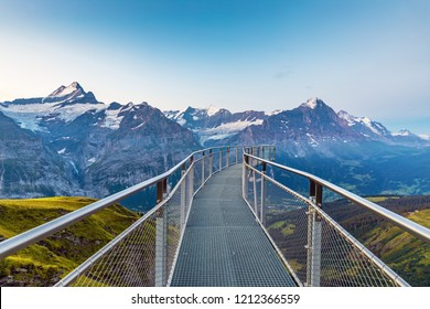 Morning panorama view. Popular tourist attraction skywalk at the first station.  Location place Swiss alps, Grindelwald valley, Europe.