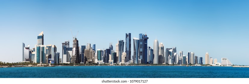 The morning panoramic view of the skyscrapers of Doha from the Persian Gulf. Futuristic skyline in the financial district of Qatar