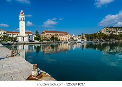 Morning photo in harbor of Zakynthos city.View of the town hall and Saint Dionysios Church, Ionian Sea, Zakynthos island, Greece. Typica Greek church tower