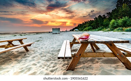 Morning at a public resting sandy beach of the Baltic Sea, concept of summer happy vacation