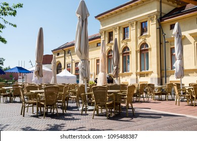 Morning relax in cozy cafe located in the building with old historical architecture on the central square of the towntown of Szeged, Hungary