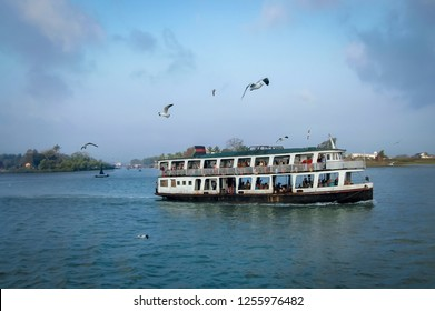 Morning scene of local public ferry depart from Sittwe township on Kaladan River and flock of seagulls, Myanmar.