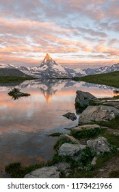 Morning shot of the golden Matterhorn (Monte Cervino, Mont Cervin) pyramid and  blue Stellisee lake. Sunrise view of majestic mountain landscape. Swiss Alps, Zermatt, Switzerland.
