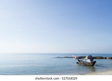 Morning sky at  beach and fishing boats.