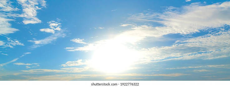 The morning sky looked like a bright golden sky. The sunrise is decorated with clouds in various shapes. Looks beautiful.
