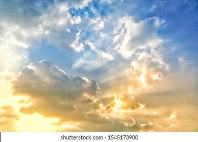 Morning sky with sunlight. Cloudscape of sunrise. Sun light through the cloud.