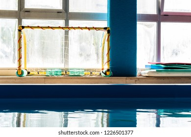 Morning in a small pool for water polo for kids.