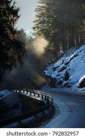Morning at the snowy mountains road in Austrian alps in winter