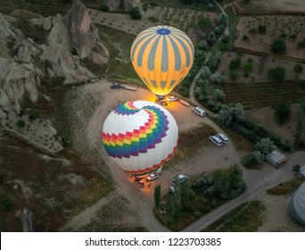 Morning start of a Hot air balloons (atmosphere ballons) flying over mountain landscape at Cappadocia, UNESCO World Heritage Site since 1985) - Turkey