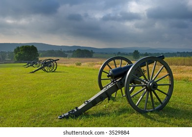 Morning storm clouds over a row of cannon at Antietam Battlefield at Sharpsburg, Maryland, USA