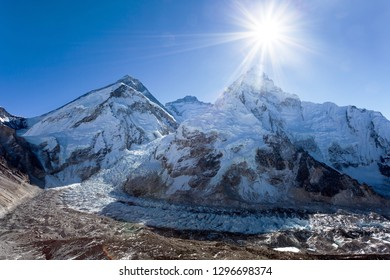 Morning sun above Mount Everest, lhotse and Nuptse from Pumo Ri base camp - Way to Everest base camp - Sagarmatha national park - Nepal Himalayas mountains