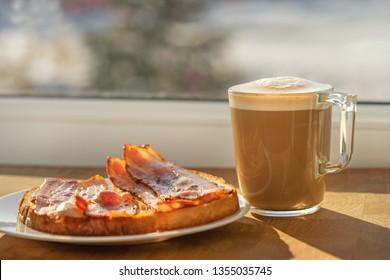 morning sun breakfast cappucino coffe sandwich bacon.