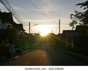 Morning sun shining above a small village