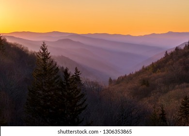 Morning sunlight dawns on the foggy ridges and valleys of Great Smoky Mountains National Park near the Tennessee and North Carolina border.