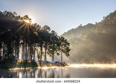 Morning sunlight and misty reservoir at Pang Oung or Pang Tong Royal Project (Mae Hong Son, Thailand)