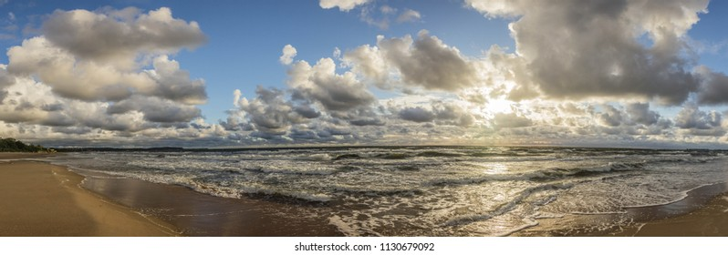Morning sunrise at the beach with cloudy, summer, bright sky and clouts.