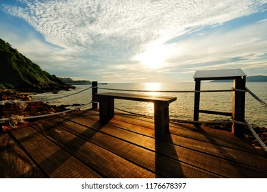 Morning sunrise and beautiful sea view with wooden balcony at Rayong Beach, Thailand.