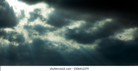 Morning sunrise between rainy clouds scene