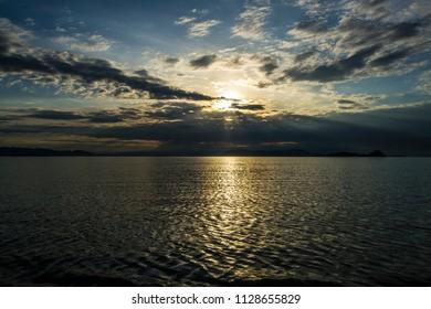 Morning sunrise by the lake shore