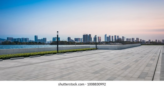 morning sunrise city skyline park lake clear calm water