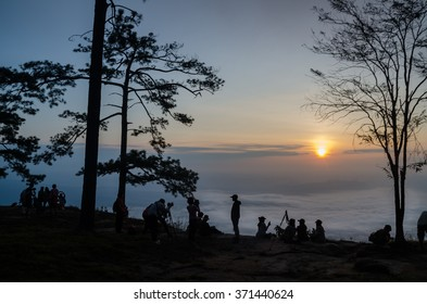 Morning sunrise with fog at Pha Nok Ann (Swallow Cliff) on Phu Kradueng national park, Thailand. Silhouette landscape.