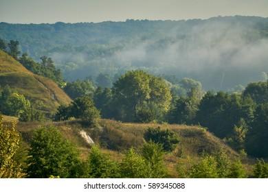 Morning sunrise and foggy landscape.