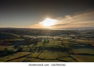 Morning Sunrise Malham North Yorkshire Yorkshire Dales Frost WInter Ariel Drone Flare Hills Grassland Walls Trees countryside uk
