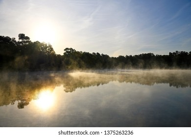 Morning Sunrise with Misty Fog Rising From the Lake