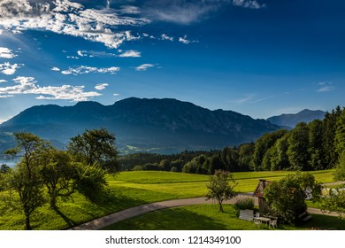 Morning sunrise in Nußdorf over the Attersee lake with green grass and mountains in background near Salzburg, Upper Austria