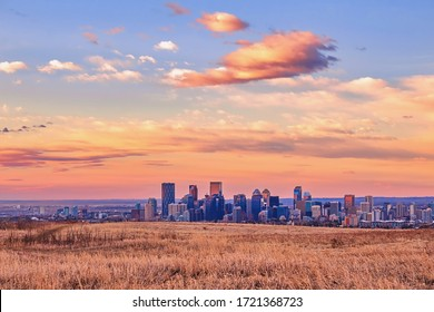 Morning sunrise over a field by downtown Calgary