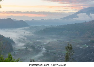 It's a morning sunrise photogenic view of mount Batur from a hill located in Pinggan Village near Kintamani area, Bali, Indonesia.