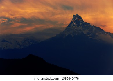 Morning sunrise sky of Unclimbable Nepalese mountain peak of Machapuchare, fishtail and Annapurna peak in the Annapurna Himalayas of north central Nepal. View from Australian Base Camp, Pokhara, Nepal