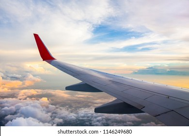 Morning sunrise with Wing of an airplane. Photo applied to tourism operators. picture for add text message or art work frame website. Traveling concept.