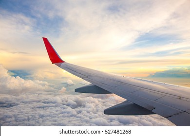 Morning sunrise with Wing of an airplane. Photo applied to tourism operators. picture for add text message or frame website. Traveling concept