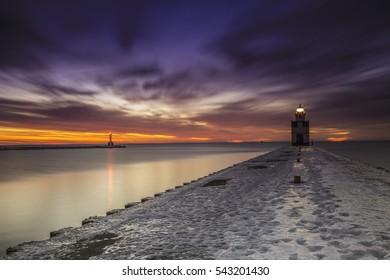 Morning sunrises long exposure image of the lighthouse along Lake Michigan in Wisconsin.